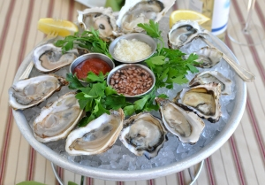 raw oysters with condiments